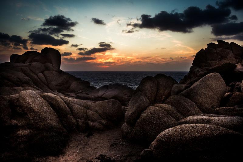 Capo Testo Sardinien Italien Family Felsenmeer Gegenlicht Klippen Leuchtturm Meer Sonnenuntergang Urlaub & Reisen Abendstimmung Am Meer Beauty In Nature Brandung Felsen Felsenlandschaft Nature Outdoors Sky