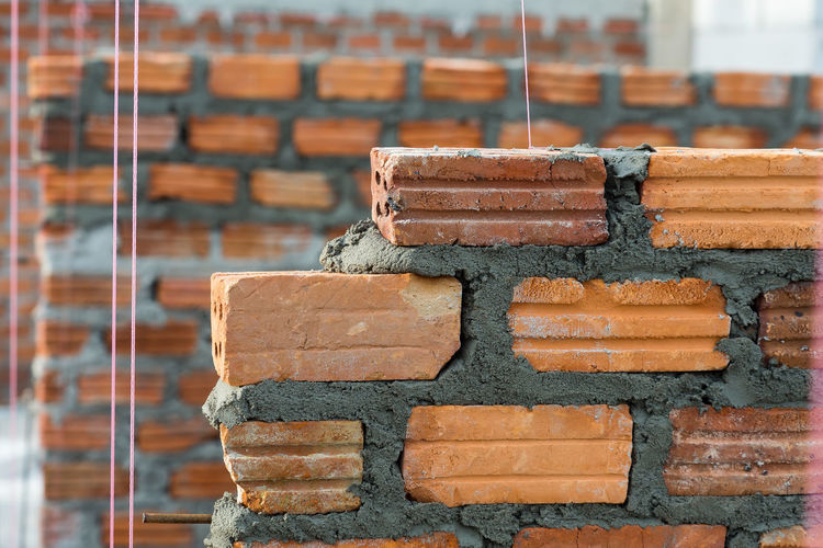 bricks wall in construction site Construction Construction Site Architecture Arrangement Brick Wall Built Structure Close-up Construction Work Day Focus On Foreground New Bricks Wall No People Outdoors Stack
