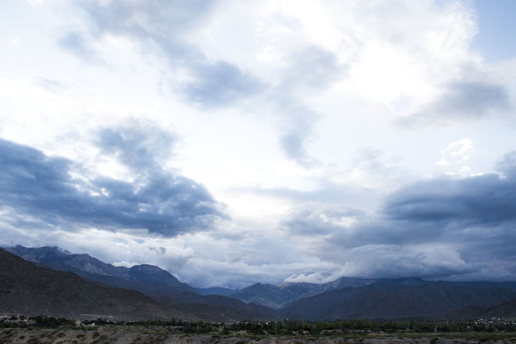 Scenic view of landscape and mountains against sky