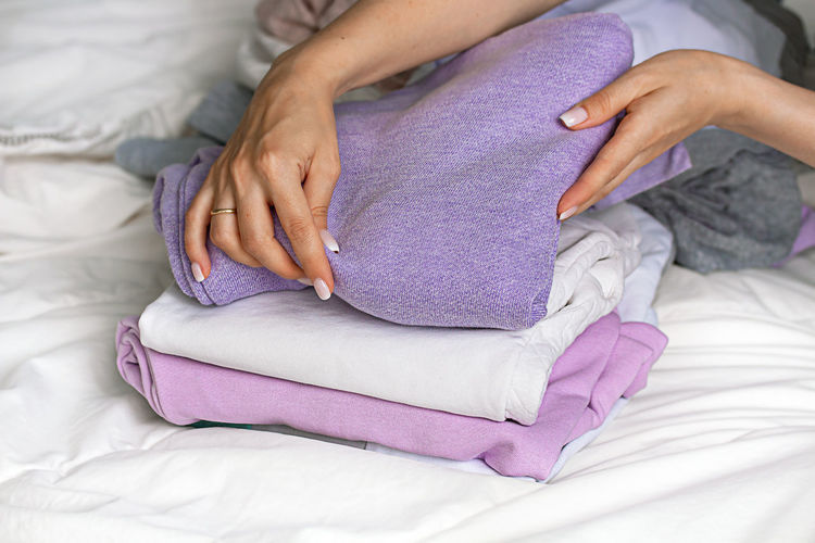 Midsection of woman resting on bed