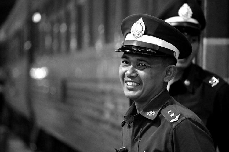 Thai smile Bangkok Bangkok Thailand. Railwaystation Train Policeman Proud Man Traveling Travel Photography Travel Travelingtheworld  Smile Happymeeting Portrait Security Blackandwhite Black & White Blackandwhite Photography