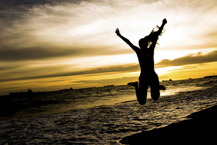 Jump Life Arms Raised Beach Beauty In Nature Cloud - Sky Horizon Over Water Human Arm Land Leisure Activity Lifestyles Nature One Person Orange Color Outdoors Real People Scenics - Nature Sea Silhouette Sky Sunset Water