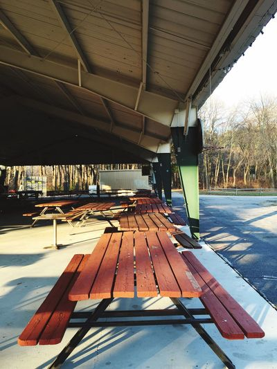 Pavilion Outdoor Events Sunlight And Shadow Long Shadows Picnic Picnic Tables Picnic Ground Shadows Outdoors Outdoor Buildings Empty Places Empty Eating Outside Eating Outdoors Green Red