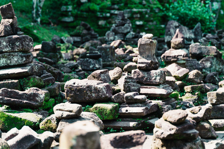 Stack of stones on rocks in forest