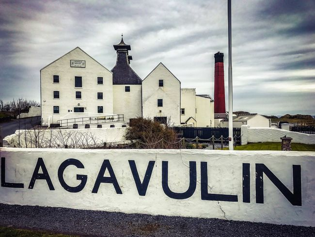 Lagavulin Distillery Whisky Scotch Scotch Whisky Architecture Built Structure Western Script Text Building Exterior Sky Communication Warning Sign Guidance Cloud - Sky Day Outdoors No People Road Sign Water Nature