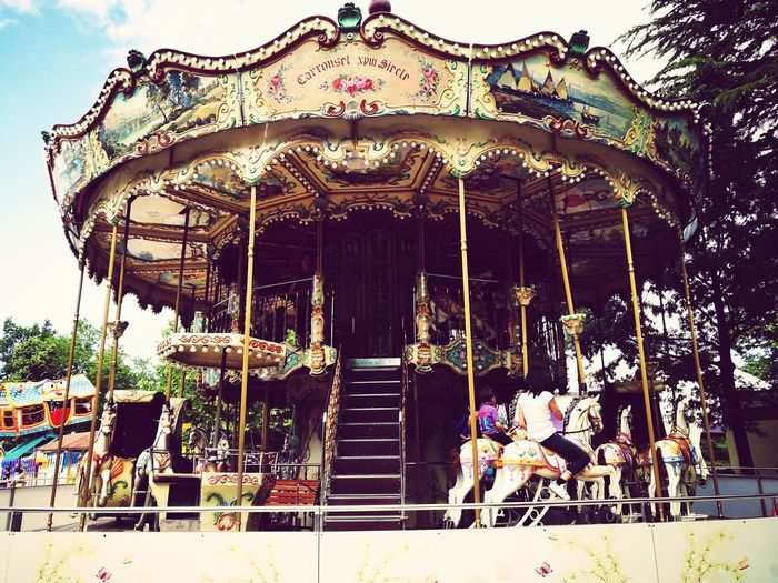 Amusement Park Arts Culture And Entertainment Carousel Fun Enjoyment Merry-go-round Carousel Horses Childhood People Sky Amusement Park Ride Leisure Activity Outdoors Day Live For The Story The Street Photographer - 2017 EyeEm Awards The Photojournalist - 2017 EyeEm Awards