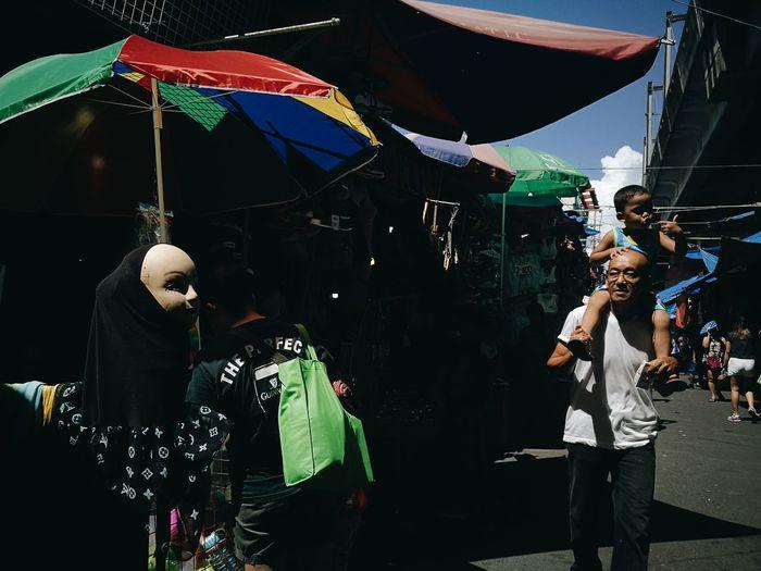People standing against multi colored umbrella