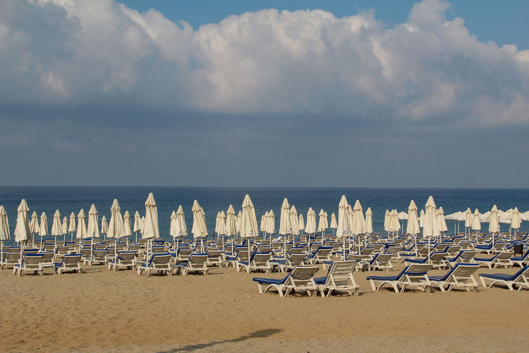 Water Beach Sea Sky Land Chair Cloud - Sky Horizon Over Water Scenics - Nature Sand Tranquility In A Row Beauty In Nature Nature Horizon Lounge Chair Tranquil Scene Absence Seat No People Outdoors Order Travel Alanya Turkey