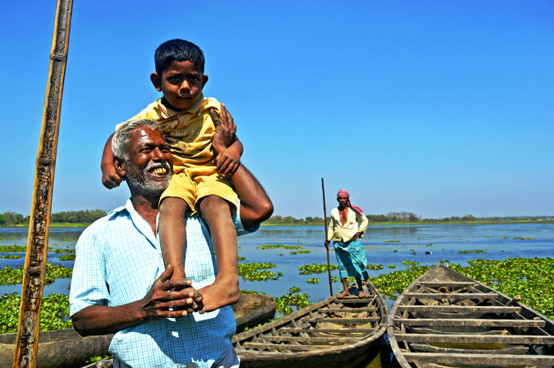 This place name is Fotai Pur near Tehatta (West Bengal, India). Jahidul Khan is an oarsman. Jahidul Khan always takes his beloved grandson Akbar with him. bonding boys child childhood day emotion #Emotion #front View #smiling #innocence #looking At Camera #Males #Men #hot #crushes #family #happiness #followme #brunette #outdoors #sunshine #portrait #portraits #moodygrams #portraits_ig #portraitphotography #portrait_perfection #moodyports #snowisblack #portraitphotographer #portraitgame #portrait_shots #bleachmyfilm #portraitmood #featurepalette #ftmedd 🇹🇳 #positive #sky Son Serra De Marina This Is Family Togetherness Friendship