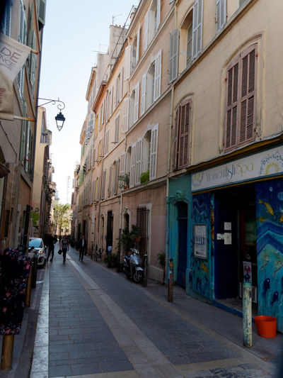 Streetphotography Street Street Photography Marseille Cityscape Alley Building Exterior Architecture Built Structure City Residential District Building The Way Forward Day Footpath Direction Outdoors Sidewalk Summer Motor Vehicle City Life Road