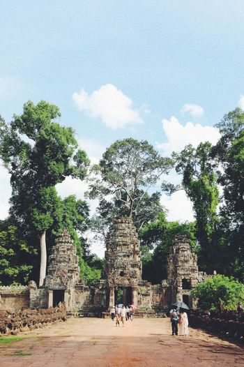 Ancient Ancient Civilization Architecture Building Exterior Built Structure Cambodia Cloud - Sky Day History Men Nature Old Ruin Outdoors People Place Of Worship Real People Sky Spirituality Travel Travel Destinations Tree Two People Women