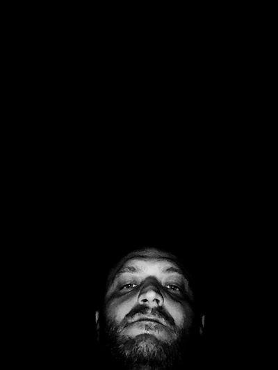 Portrait of a man against black background