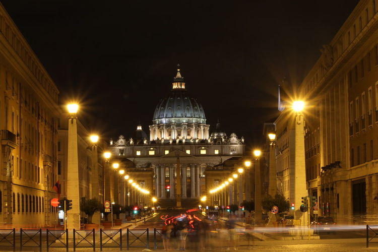 Illuminated St Peter Basilica Against Sky At Night