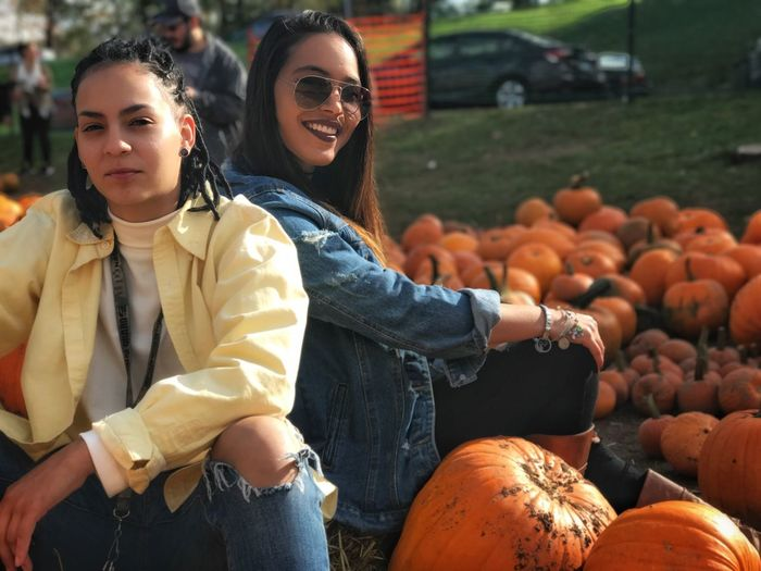 Pumpkin Picking With My Bestfrand 🎃lLooking At CamerasSmilingyYoung AdultyYoung WomencCasual ClothingpPumpkintTwo PeoplehHappinesslLifestylesfFront ViewrReal PeopleoOutdoorssStandingfFriendshiptTogethernessdDayhHalloweenbBeautiful WomancCheerful