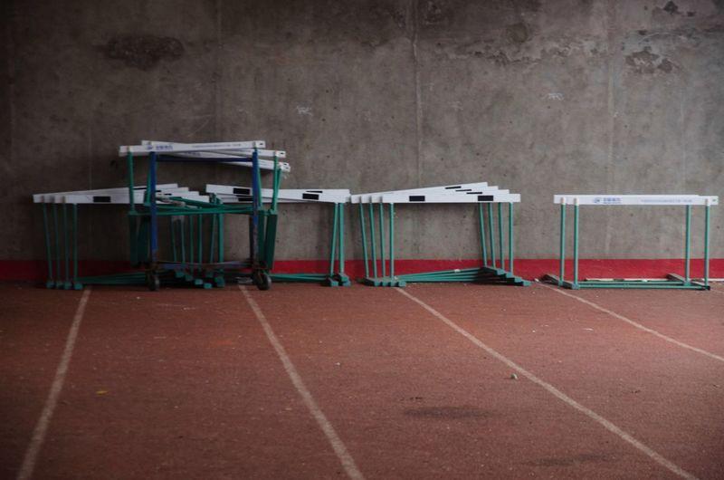 Hurdles kept against wall