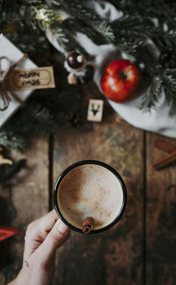 Drink Hand Holding Christmas Cup Coffee One Person Directly Above Frothy Drink Coffee - Drink Indoors  Christmas Ornament Hot Drink High Angle View Cinnamon Apple Xmas Coffee Christmas Decoration Holiday Moments