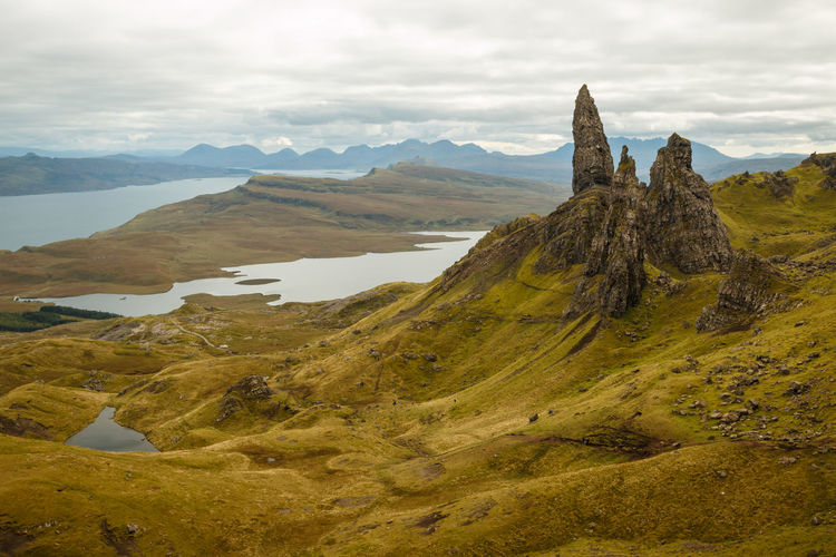 Scenic view of Old Man of Storr. - Isle of Skye, 2017 Scenics - Nature Mountain Tranquil Scene Beauty In Nature Sky Cloud - Sky Environment Tranquility Landscape Non-urban Scene Mountain Range Nature Day Idyllic Remote Land Travel Destinations Rock Physical Geography Outdoors Formation Mountain Peak Rock Formation Old Man Of Storr Scotland Trotternish Inner Hebrides Isle Of Skye Wilderness Tourist Attraction  The Great Outdoors - 2019 EyeEm Awards