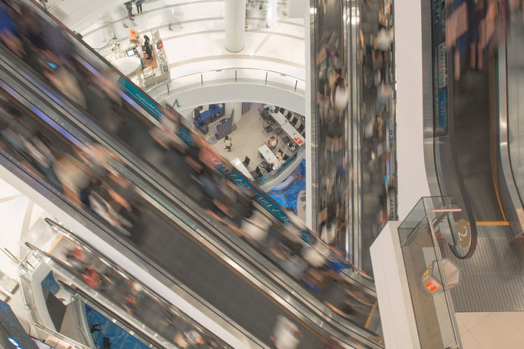 Architecture Blurred Motion Blurry Built Structure City Consumerism Conveyor  Customer  Day Escalator Film Tone Indoors  Large Group Of People Modern Motion Movement People Retail  Sale Shopping Mall Store