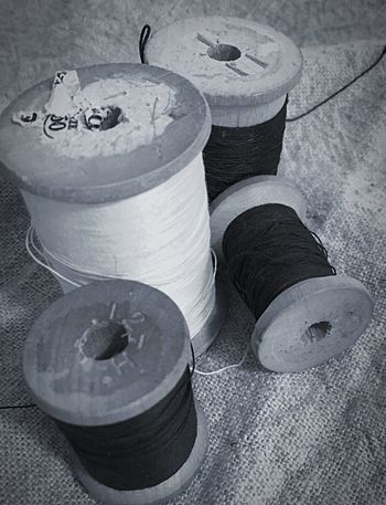 A stitch in time Monochrome Black And White Wooden Spools Spools Of Thread Thread Sewing Still Life High Angle View No People Close-up Art And Craft Container Day Craft Group Of Objects Textured
