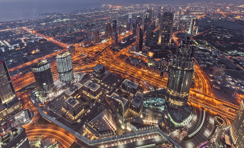 aerial view over Dubai in the evening, UAE, Middle East Building Exterior City Architecture Cityscape Built Structure Building Aerial View Office Building Exterior High Angle View Illuminated Travel Destinations Night Skyscraper Modern Crowded Tower City Life Nature Outdoors Financial District  Dubai