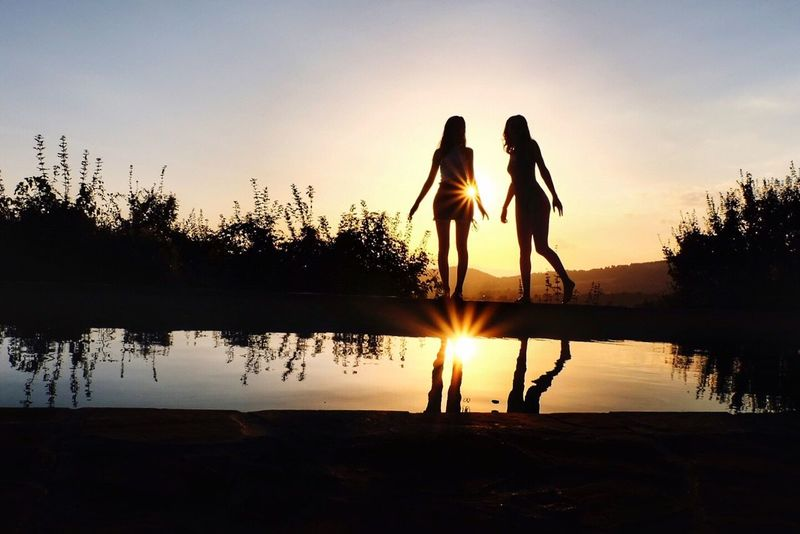 No caption needed Sunset Umbria Umbria, Italy Two People Full Length Reflection Water Real People Togetherness Leisure Activity Silhouette Nature Sky Lifestyles Outdoors Friendship Beauty In Nature Standing Tree Women Scenics Men