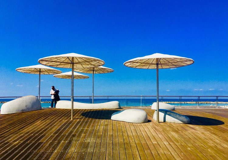 Sky Umbrella Water Real People Nature Parasol One Person Clear Sky Day Blue Beach Protection Outdoors