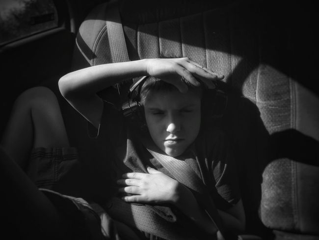 Ya, he was really hating the sun right then!🌞😎😂✌ Bnw_friday_eyeemchallenge Bnw_expression Exceptional Photographs Taking Photos Outdoors EyeEm Best Shots Eye4photography  EyeEm Gallery Thats My Boy  Myson Boy Autistic Autismdad Autism Blackandwhite Black And White Blackandwhite Photography Monochrome First Eyeem Photo Tranquil Scene Blancoynegro Black And White Collection  Shadow Sunshine In The Car Car Interior Young Adult