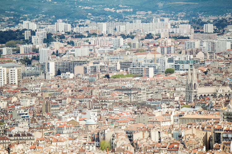 High angle view of residential district and buildings in city