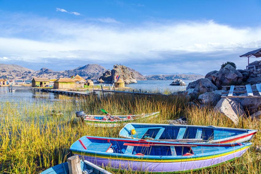 Colorful boats near floating islands on Lake Titicaca near Copacabana, Bolivia American Background Boats Bolivia Color Colorful Copacabana Floating Houses Inca Indigenous  Islands La Paz Lake Latin Native Nature Pattern Peru South America Titicaca Titicaca Lake Traditional Travel World