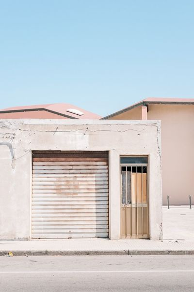 EyeEm Selects Architecture Building Exterior Built Structure Clear Sky Copy Space Door Outdoors No People Day Sky Urban Architecture Pastel Power