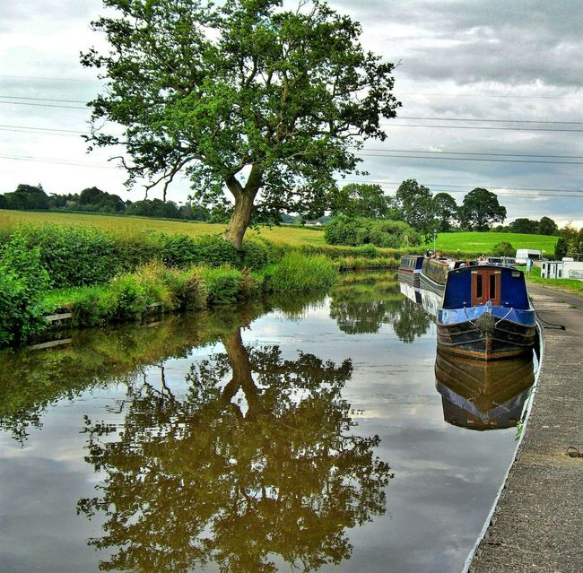 Canal Narrowboat Reflections In The Water Scenery By The Water Beauty In Nature Trees And Sky Boats Waterway Transportation Scenic View Old Way Of Transportation Countryside Towpath