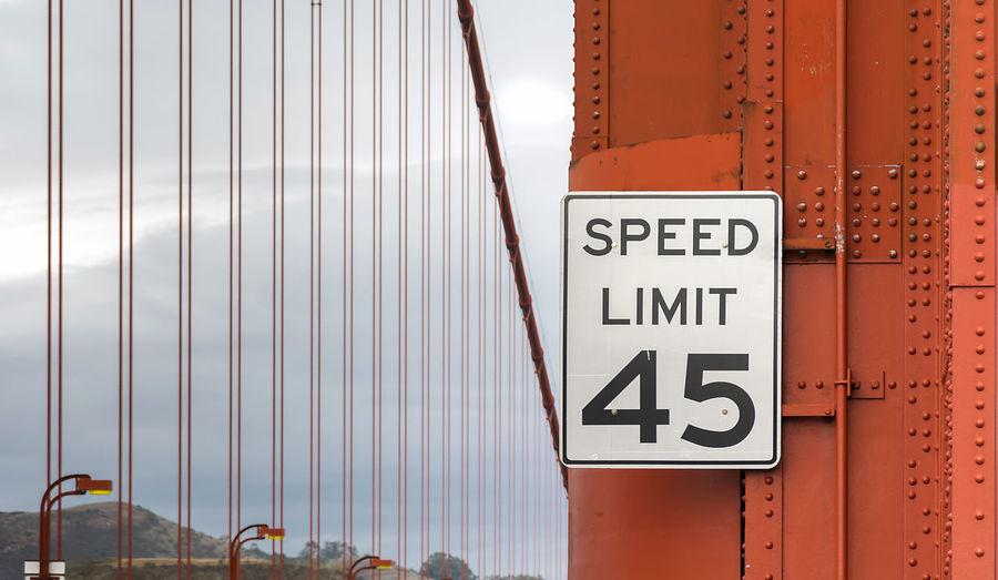 Close-up of speed limit sign on bridge
