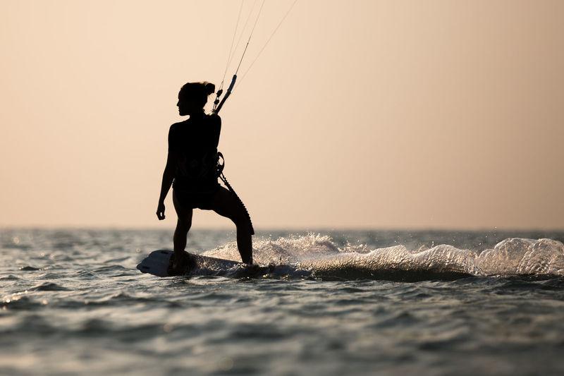 Kitesurfing, kiteboarding in exotic location, tropical island. kitesurfer activities.