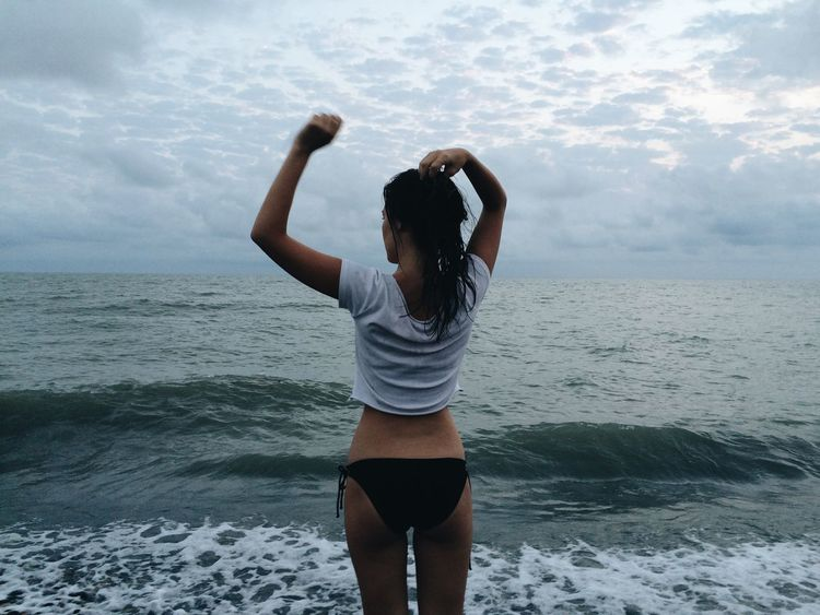 Beach Beauty In Nature Day Horizon Over Water Leisure Activity Lifestyles Nature One Person Outdoors Real People Rear View Scenics Sea Sky Standing Three Quarter Length Young Women