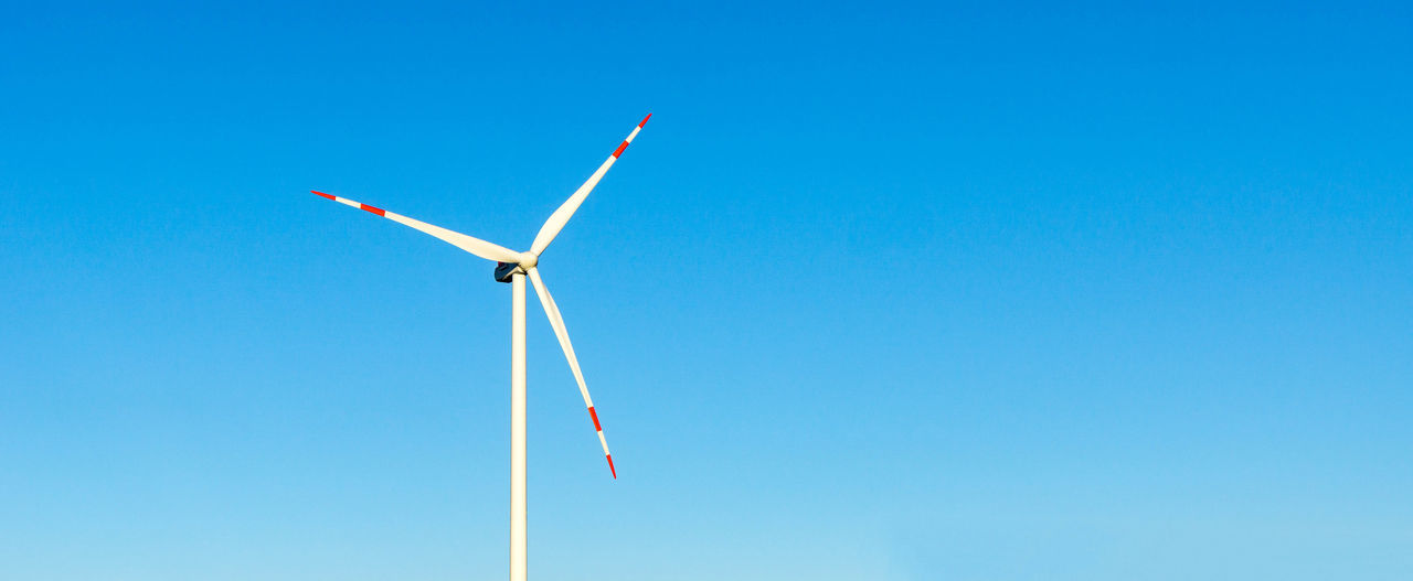 wind turbine and blue sky Alternative Energy Blue Clear Sky Copy Space Day Environment Environmental Conservation Fuel And Power Generation Low Angle View Nature No People Outdoors Power In Nature Power Supply Renewable Energy Sky Sustainable Resources Technology Turbine Wind Wind Power Wind Turbine