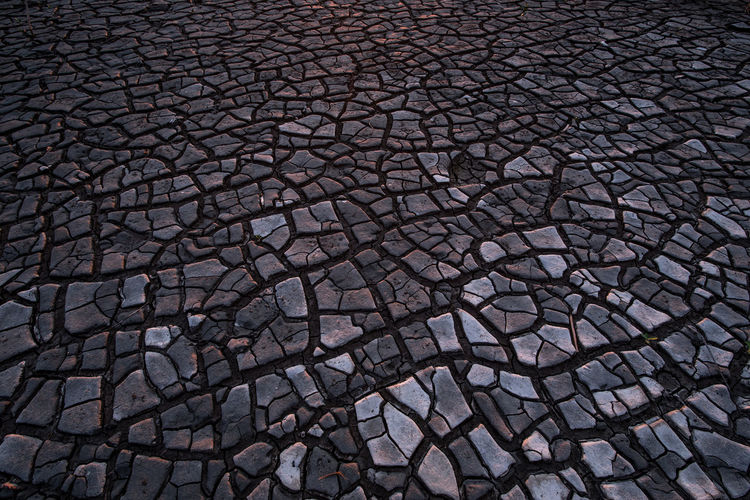 Cracked land Street Architecture Nature City Day Outdoors Design Shape Low Tide Pattern Cracked Cobblestone Gray Environment Footpath Textured  No People Backgrounds Full Frame Geometric Shape High Angle View Arid Climate Climate Textured  Barren