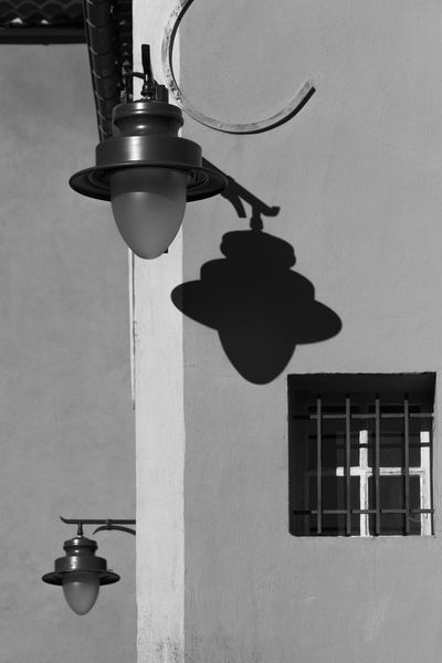 Houses Architecture Black And White Black And White Photography Building Exterior Built Structure Close-up Day Electric Lamp Electricity  Hanging Illuminated Indoors  Lantern Light Bulb Lighting Equipment Low Angle View No People Shadow Straight Lines Street Lamp Wall Lamp Window