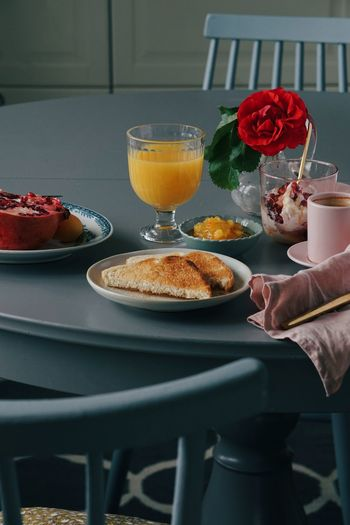 Midsection of man having breakfast on table