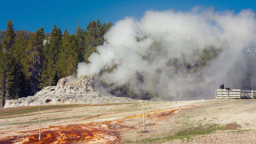 Beauty In Nature Castle Geyser Geothermal  Geothermal Activity Geyser Landscape Nature Non-urban Scene Outdoors Physical Geography Scenics Steam Travel Destinations Unrecognizable Person Upper Geyser Basin Wyoming Yellowstone National Park