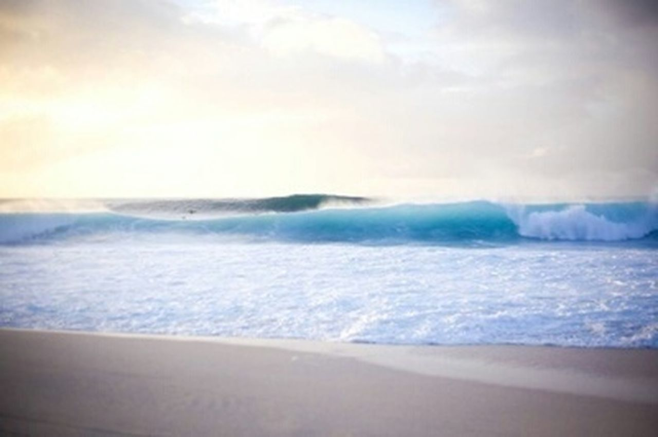 sea, wave, surf, scenics, nature, beauty in nature, sky, beach, horizon over water, no people, motion, cloud - sky, outdoors, tranquil scene, tranquility, water's edge, water, cold temperature, sunset, vacations, power in nature, winter, day