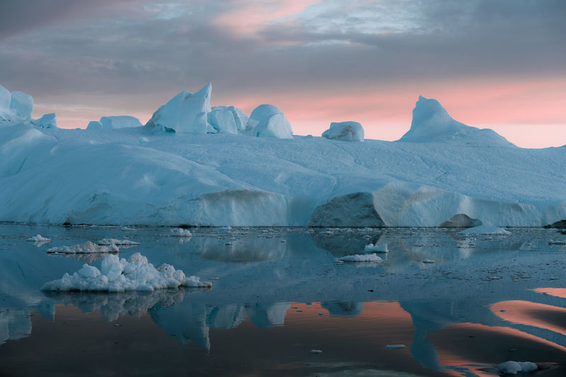 """Icebergs in a sunset depicting the color pantone of the year """"living coral"""" Water Ice Cold Temperature Glacier Sky Landscape Environment Beauty In Nature Frozen Winter Scenics - Nature Tranquil Scene Waterfront Tranquility Iceberg Sunset Reflection Nature Snow No People Floating On Water Melting Snowcapped Mountain Lagoon"""