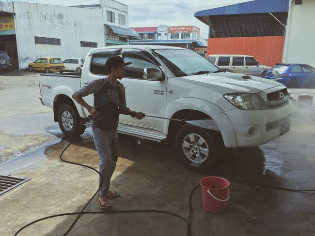 Car Transportation Full Length Land Vehicle Mode Of Transport Real People One Person Standing Day Stationary Lifestyles Outdoors City Building Exterior One Man Only Men Adults Only Only Men People Adult Carwash Carwashing Tawau Waterjet