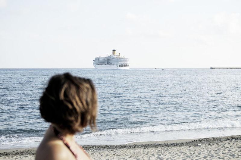 A woman looks at a ship on the horizon (Cannes, France) Shipping  Water Sea Sky Land Beach One Person Leisure Activity Horizon Over Water Beauty In Nature Looking At View Outdoors Scenics - Nature Headshot Hairstyle Nature Horizon Lifestyles Day Shoreline France Cannes, France Côte D'Azur EyeEm Best Shots EyeEm Selects
