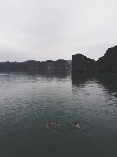 Swimming at Halong Bay FUJIFILM X-T2 Cat Ba Island Friendship Alone Time Fiord Fiordland Water_collection Leisure Activity Lifestyles Landscape EyeEm Best Shots Swimming Swimming Time Vietnam Halong Bay  Baignade EyeEmNewHere Summertime Summer Diving EyeEm Best Edits Water Halong Bay Vietnam Swimming Sky Friend Water Sport The Traveler - 2018 EyeEm Awards