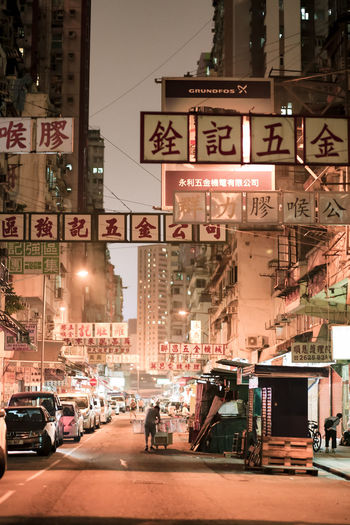 Hong Kong Architecture Building Building Exterior Built Structure Car City City Life City Street Communication Illuminated Incidental People Land Vehicle Mode Of Transportation Motor Vehicle Night Outdoors Road Sign Street Text Transportation The Street Photographer - 2018 EyeEm Awards
