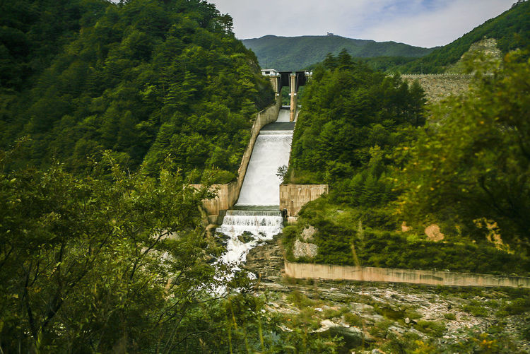 Low Angle View Of Dam And Mountains