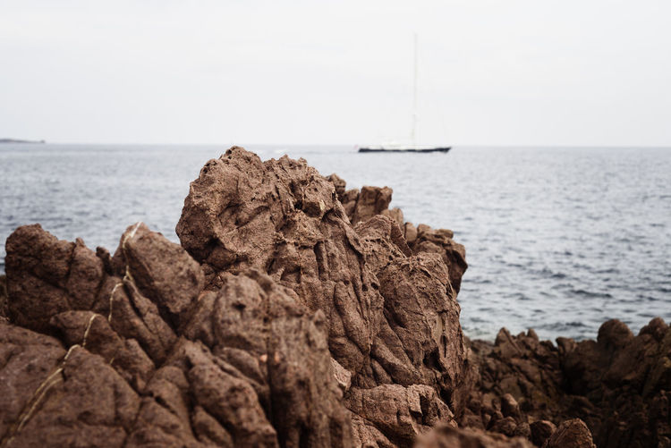 Red cliff (Cannes, France) Ship Sea Water Rock Rock - Object Solid Sky Horizon Horizon Over Water Tranquility Scenics - Nature Non-urban Scene No People Beauty In Nature Beach Tranquil Scene Rock Formation Nature Red Color Wind Mediterranean  France Côte D'Azur Cannes EyeEm Nature Lover