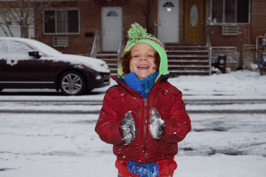 Mischievous Winter Snow Childhood Cold Temperature Smiling Warm Clothing Fun Happiness Front View Elementary Age Enjoyment One Person Knit Hat Real People Child Cheerful Cute Outdoors