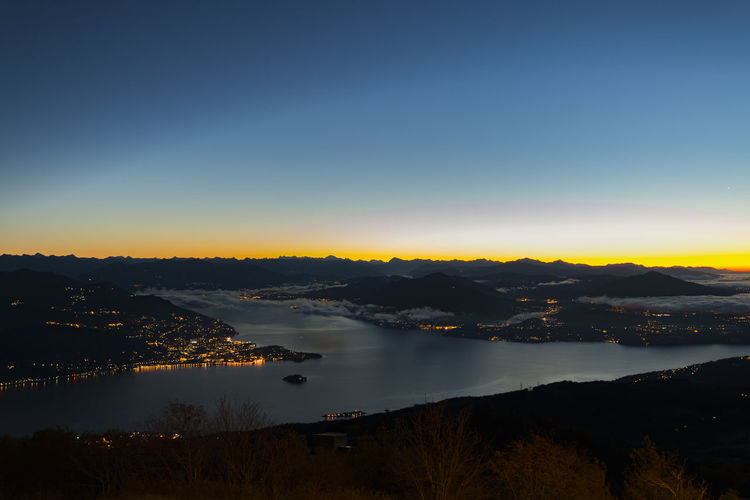 Scenic View Of Lake Maggiore During Sunset