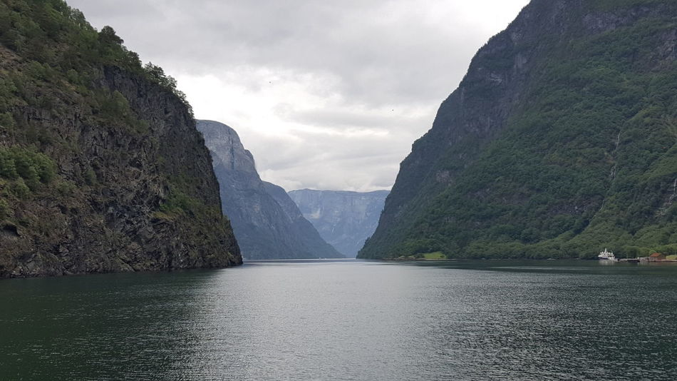 """The Nærøyfjord (or Nærøyfjorden) is a fjord in the municipality of Aurland in Sogn og Fjordane, Norway. The narrow fjord is a branch of the large Sognefjord, and it is featured on the """"Norway in a Nutshell"""" daytrips for tourists. The 18-kilometre (11 mi) long fjord is only 500 metres (1,600 ft) wide in some parts. The river Nærøydalselvi flows down the valley Nærøydalen into the fjord at the village of Gudvangen, near the highway E16. The village of Bakka and the Bakka church are located on the west shore of the fjord. Since 2005, the Nærøyfjord has been listed as a UNESCO World Heritage Site. It has also been rated by the National Geographic Society as the world's number one natural heritage site along with the Geirangerfjord. Nærøyfjord was also used as an inspiration for Arendelle in Frozen. EyeEm Best Shots EyeEm Nature Lover Fjord Fjord-spotting Fjordland Fjordland Norway Fjordnorway Fjords Fjordsofnorway Fjordsshot Fjördtour Fjørd Hidden Gems  Mountain Mountains Nature Nature Photography Nature_collection Naturelovers Naturephotography Nærøyfjord Nærøyfjorden The Purist (no Edit, No Filter) Unesco UNESCO World Heritage Site"""